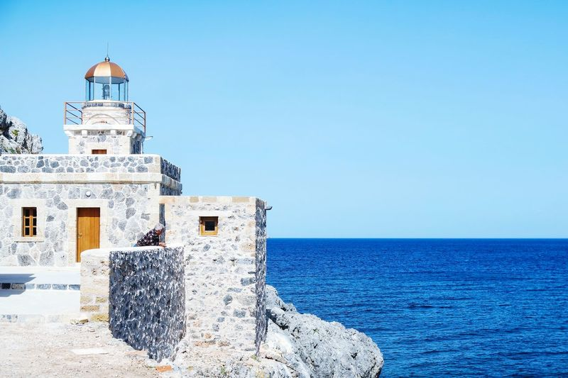 Lighthouse At Monemvasia In Sea Against Clear Sky