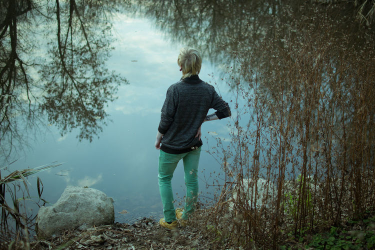 Water Tree Nature Plant Lake Beauty In Nature Autumn Teenager Teen Boy Real People One Person Lifestyles Outdoors Tranquility River Depression