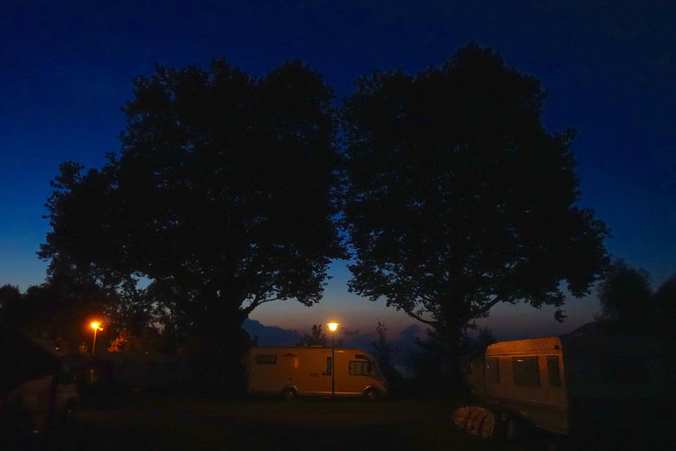 Evening light at the campground in Arbon, Switzerland. Arbon Blue Campbround Dark Evening Light Illuminated Lighting Equipment Nature Night No People Outdoors Sky Street Light Swimming Tranquil Scene Tranquility Tree