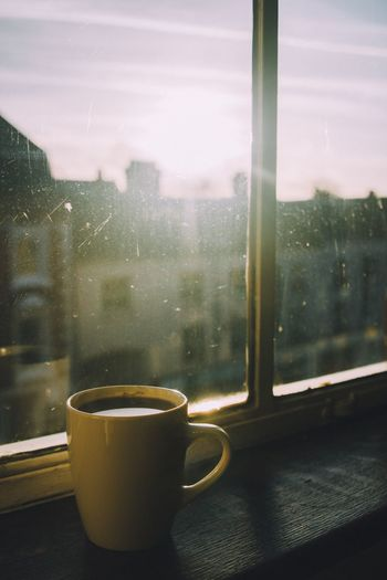 Coffee cup on window sill