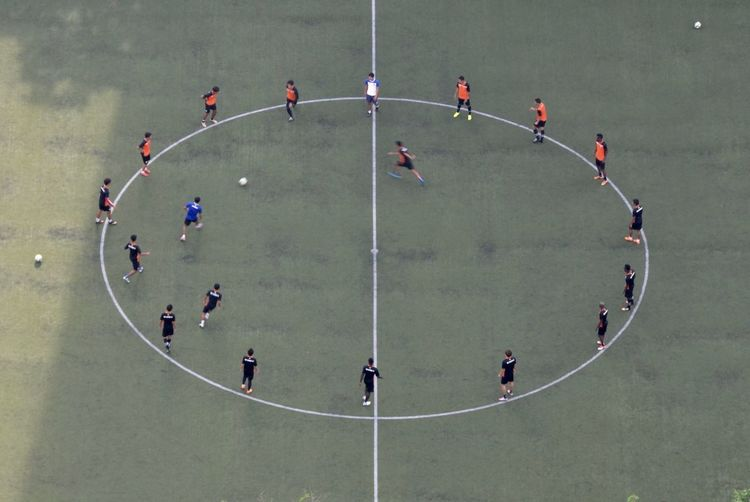 High angle view of people playing soccer on field