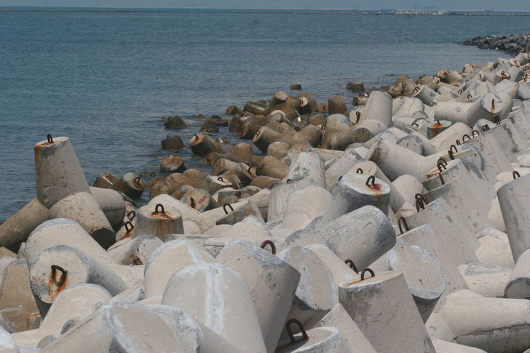 Crushers wave In Batam, Indonesia Abundance Beauty In Nature Day Groyne Idyllic Nature No People Ocean Outdoors Rippled Rock - Object Scenics Sea Shore Sky Stone - Object Tourism Tranquil Scene Tranquility Travel Destinations Water