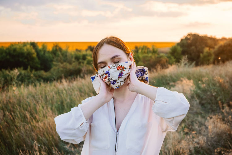 Statement masks, blinged out diy flower face mask design. girl in face mask decorated