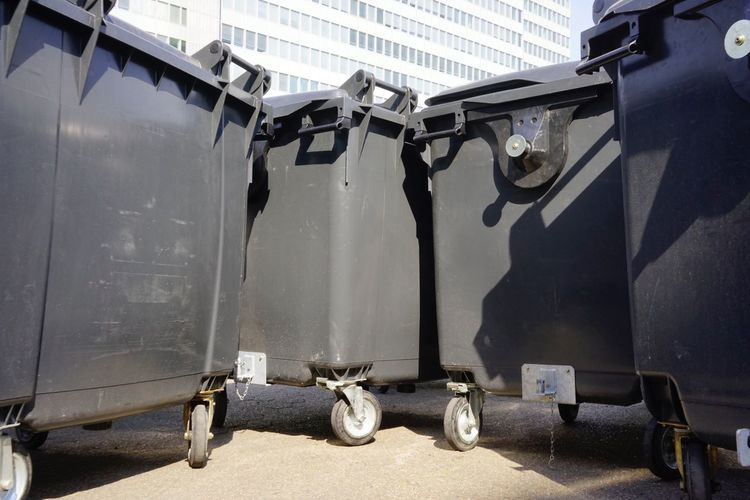 Low angle view of garbage bin in city