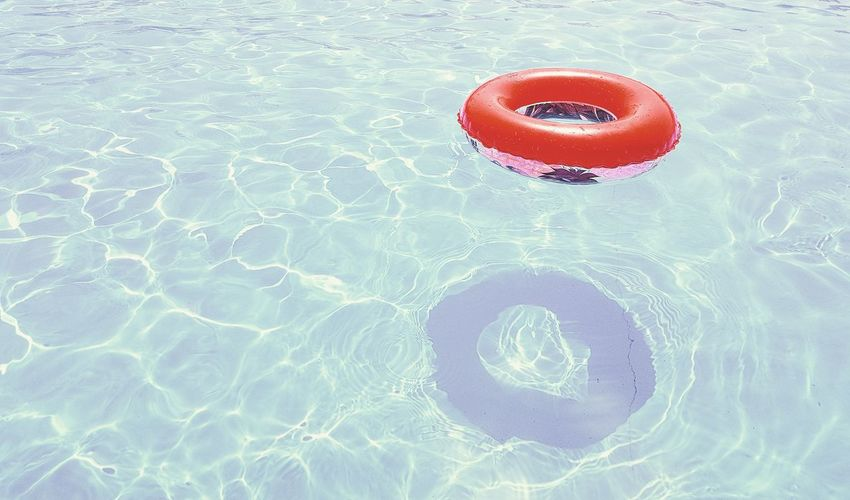 High angle view of ring floating on swimming pool