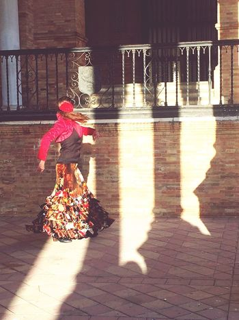 Sevilla Spain Siviglia Sevilla Enjoying Life Taking Photos Outdoor Photography Flamenco Raíces Tradition Shadow Real People Sunlight One Person Lifestyles Full Length Day Walking Rear View Women Built Structure Outdoors Architecture Leisure Activity Building Exterior People