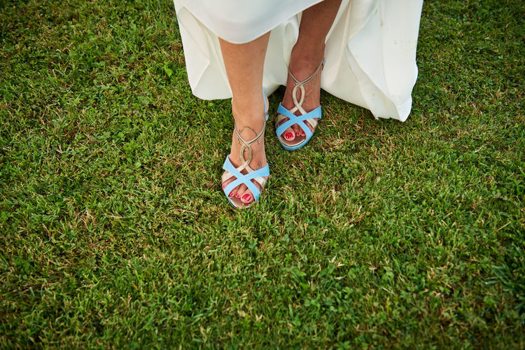 Wedding Wedding Photography Adult Ball Body Part Day Field Grass Green Color Human Body Part Human Foot Human Leg Human Limb Leisure Activity Lifestyles Low Section Nature Outdoors People Plant Real People Shoe Sock Sport Standing Women