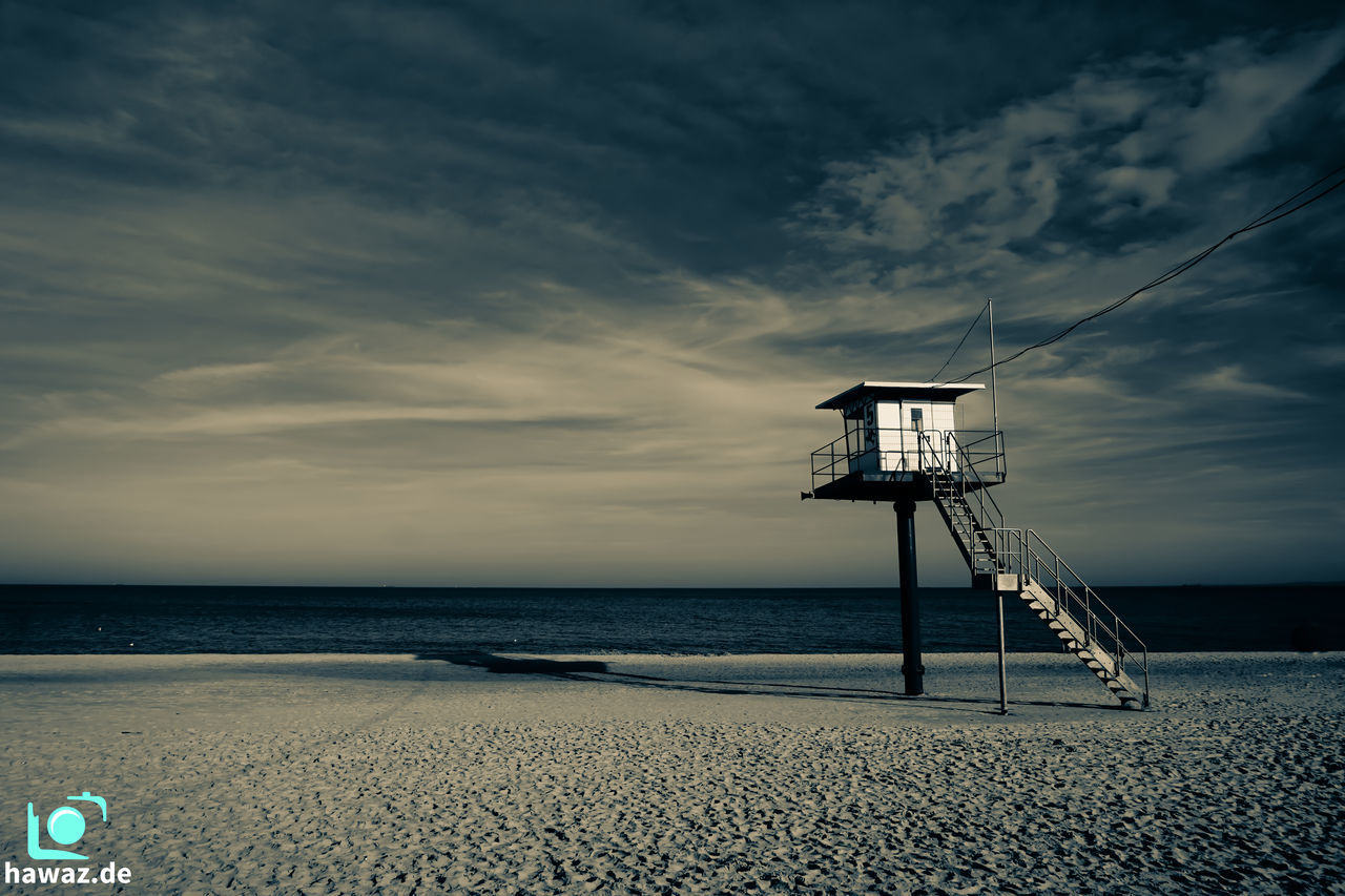 sea, beach, sky, cloud - sky, water, horizon over water, safety, sand, outdoors, beauty in nature, tranquil scene, nature, tranquility, built structure, scenics, lifeguard hut, day, lookout tower, no people, architecture