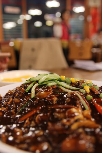 Jajangmyeon, Korean black bean sauce noodles with the cucumber slices on top at Korean restaurant, Busan, South Korea South Korea Black Bean Sauce Busan Close-up Cooked Day Focus On Foreground Food Food And Drink Freshness Healthy Eating Indoors  Jajangmyeon Meal Meat Nnodles No People Plate Ready-to-eat Selective Focus Serving Size Table