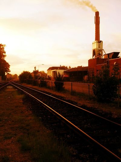 Commuting Railroad Track Rail Transportation Transportation Public Transportation Architecture Sky Built Structure Sunset Building Exterior Train - Vehicle Railroad Station Railroad Station Platform Railway Track Cloud - Sky The Way Forward Train Diminishing Perspective vanishing point Travel Orange Color