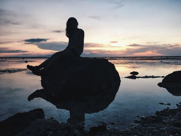 Sunset Water Silhouette Sea Rock - Object Sky Beauty In Nature Nature Beach Scenics Tranquility Outdoors Cloud - Sky Tranquil Scene One Person Real People Horizon Over Water Full Length Men Women