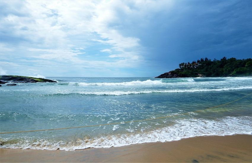 Kerala, India Travel Destinations Sea Water Beach Wave Outdoors Tide Rocks In Water No People Beauty In Nature Scenics Nature Sky Day Travel Vacations Clear Sky Power In Nature Blue Sand Horizon Over Water