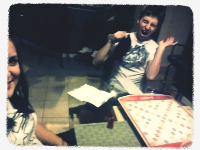 Scrabble and wine night... He's just beinga goof... Weirdo...