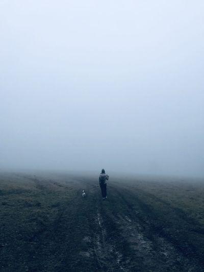 Fog woman dog empty field