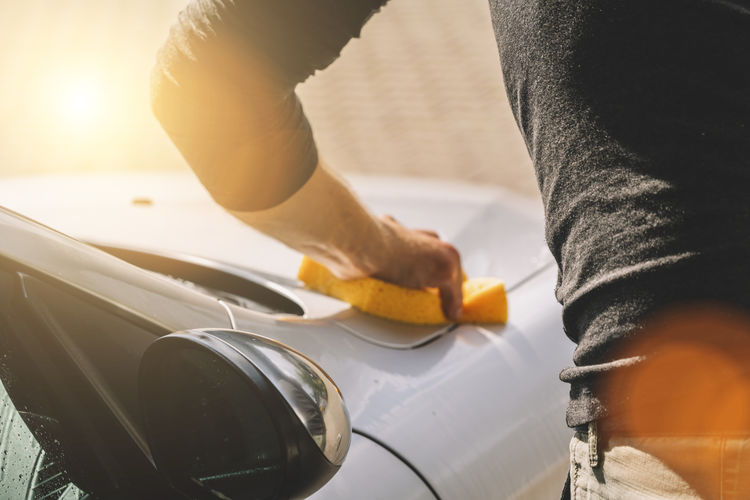 Close-Up Of Man Cleaning Car