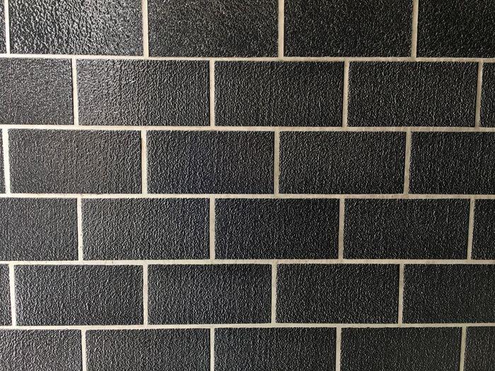 Full frame shot of black tiled wall