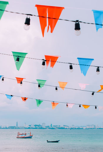 Low angle view of decorations hanging against sky