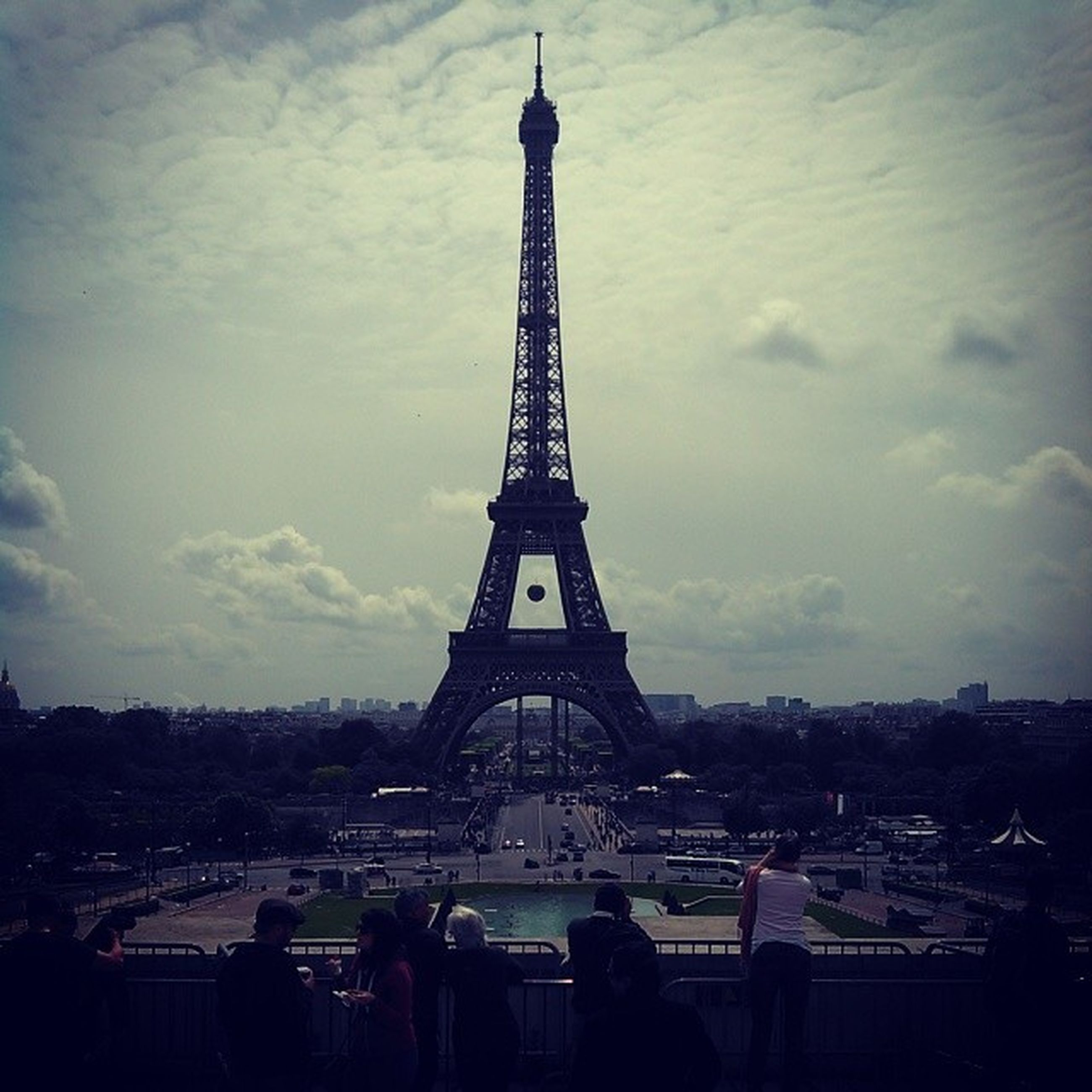 eiffel tower, architecture, built structure, famous place, international landmark, tower, tall - high, capital cities, travel destinations, tourism, culture, sky, building exterior, city, travel, history, tall, architectural feature, cloud - sky, city life