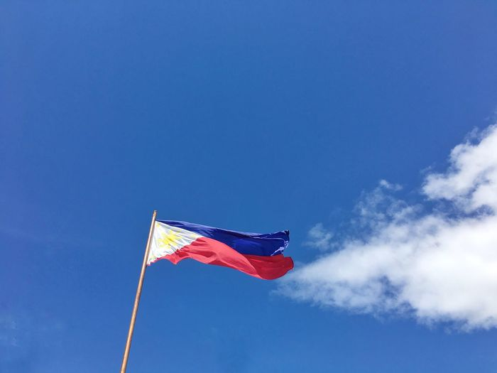 The Philippine Flag Flag Blue Low Angle View Patriotism Wind Day Waving Red Sky Outdoors No People Philippines