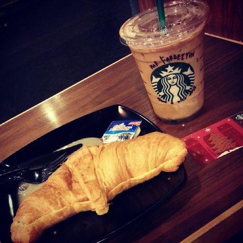 My breakfast today . Croissantadcheese Icegrandevanillalatte Starbucks . Bismillah .. :).