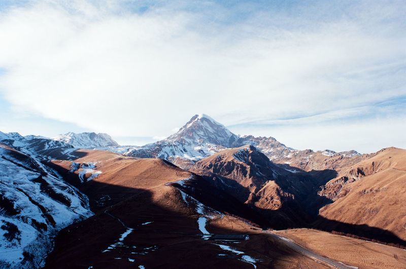 Scenic view of snowcapped mountains against sky on 35mm ekrar