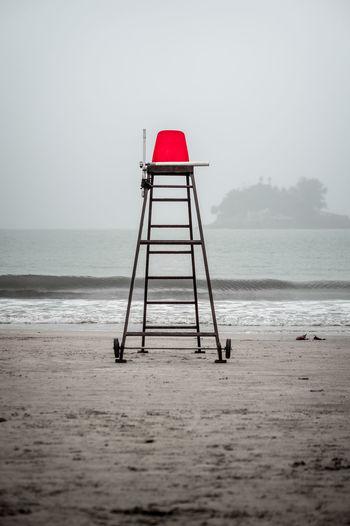Lighthouse At Beach Against Clear Sky