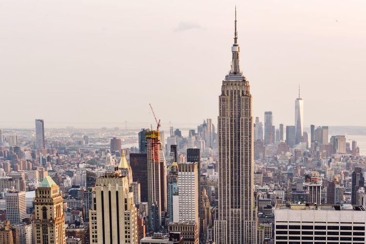 Empire state building amidst cityscape