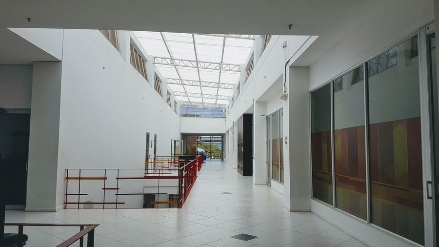 Low angle view of empty corridor in building