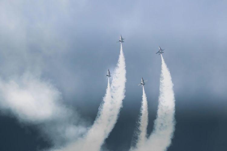 Aerobatics Aerospace Industry Air Force Air Vehicle Airplane Airshow Day Fighter Plane Flying Formation Flying Low Angle View Military Airplane No People Outdoors Perfection Performance Sky Smoke - Physical Structure Speed Stunt Teamwork Transportation Vapor Trail Go Higher Visual Creativity