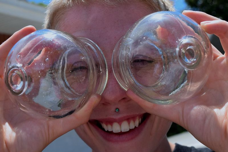 Close-Up Of Happy Woman With Cupping Glasses