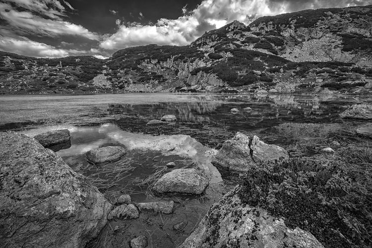 Beauty black and white landscape of lake in Rila mountain, Bulgaria Water Cloud - Sky Sky Rock Scenics - Nature Beauty In Nature Tranquility Tranquil Scene Mountain Solid Nature Rock - Object Day Lake Non-urban Scene No People Idyllic Outdoors Environment Scenics Rough Amazing Black And White Monochrome Nature_collection