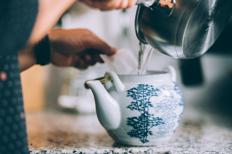 Hand Human Hand Human Body Part Indoors  Holding Teapot Lifestyles Pouring Refreshment Food And Drink Drink Preparation  Tea Tea - Hot Drink Tea Pot Tea Time Tea Time ❤ Pouring Water Pouring Making Making Tea