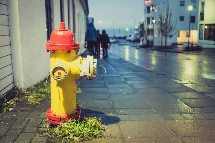 A fire hydrant on a damp Reykjavik backstreet. City Cityscape Fire Hydrant Iceland Protection Raining Reykjavik Safety Street Streetphotography Travel Traveling Wet Winter Yellow