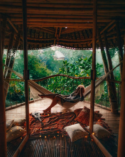 Woman relaxing in hammock at gazebo