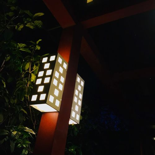 Low angle view of illuminated lamp on building
