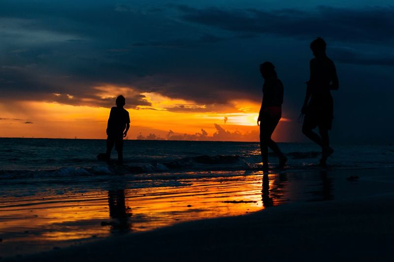 Children of the Sea Sunset Sky Water Beach Orange Color Silhouette Land Sea Cloud - Sky Beauty In Nature Real People Scenics - Nature Nature Leisure Activity Reflection Togetherness Horizon Over Water Standing Outdoors