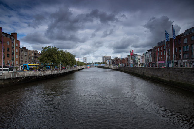 The river Liffey in Dublin, Ireland. Architecture Building Exterior Built Structure City Dark Dublin, Ireland Flowing Flowing Water Liffey Liffeybridge Liffeyriver Moody Moody Sky Ominous River Sky Water Waterfront