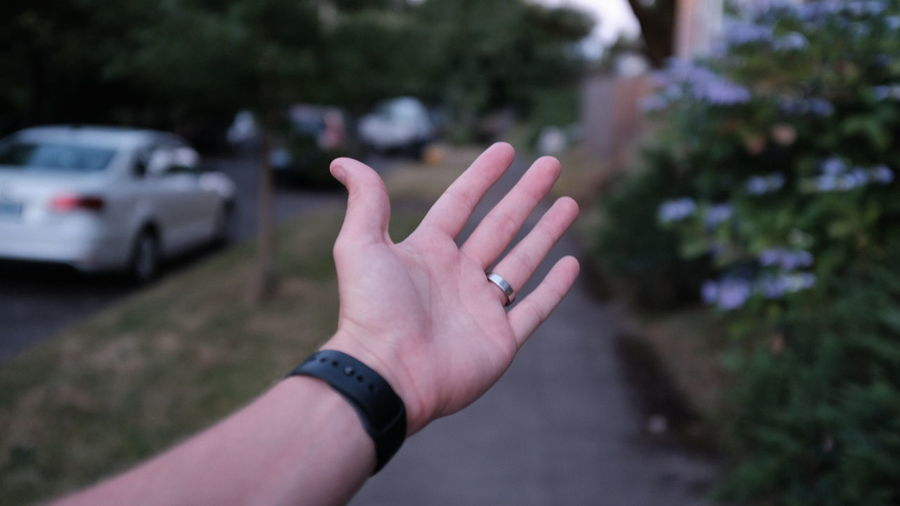 Close-up of hand on footpath