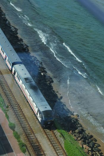 Railway track on beach, Colombo. View From Ozo Hotel Beachbar Colombo Sri Lanka Railway Track On Beach Water Sea High Angle View