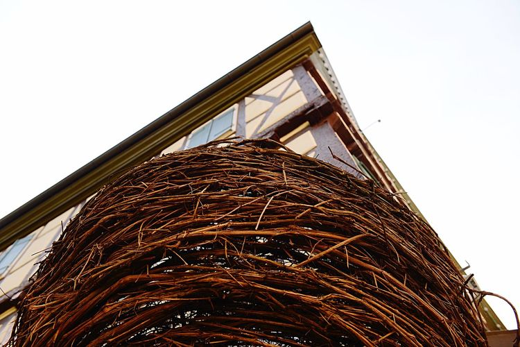 Art And Craft Weaving Craft Basketwork Wickerwork EyeEm Selects Low Angle View Sky Built Structure Architecture Clear Sky Building Exterior Day Building No People Nature Tall - High Outdoors Copy Space Brown