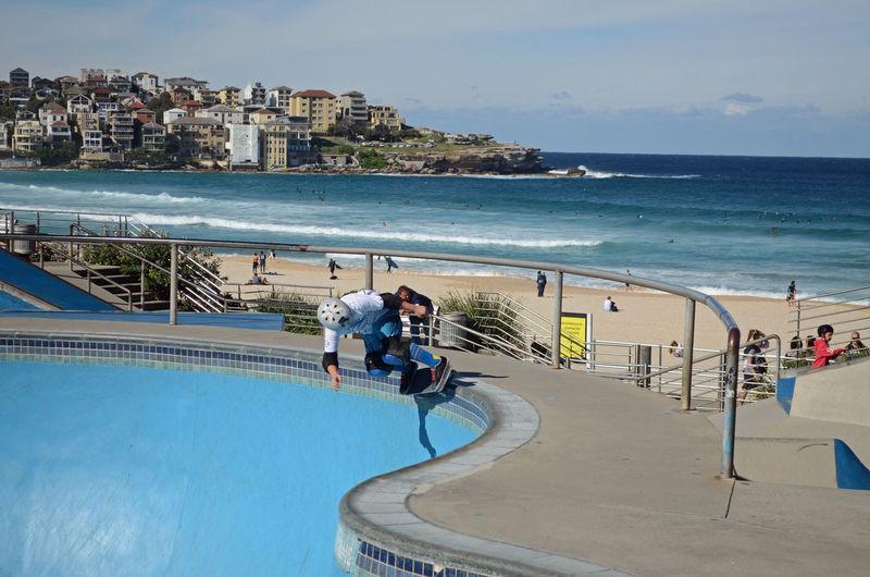 Man Skateboarding On Ramp At Beach