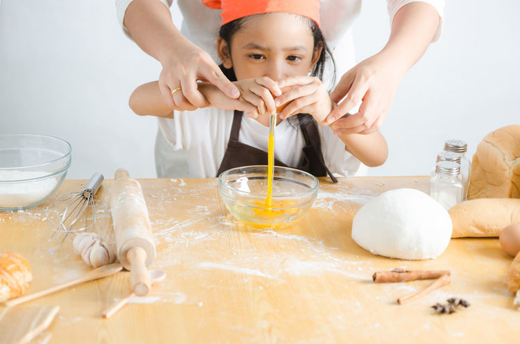 Bowl Childhood Domestic Kitchen Domestic Life Domestic Room Dough Egg Egg Yolk Elementary Age Flour Food Food And Drink Freshness Girls Human Hand Indoors  Kneading Learning Lifestyles Mixing Mixing Bowl Preparation  Real People Rolling Pin Table