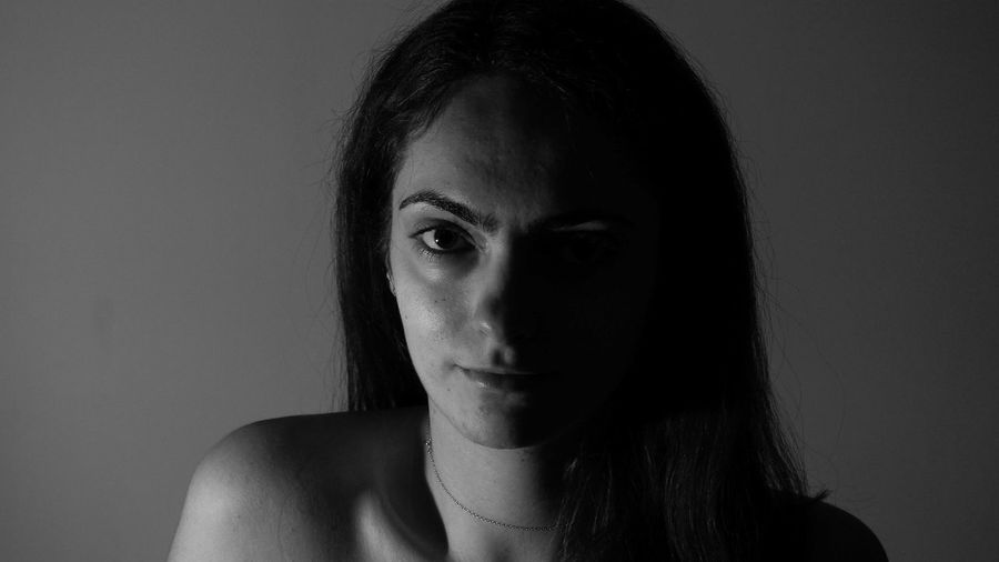 Beauty in the dark EyeEmNewHere Portrait Of A Woman Eyeemphotography EyeEm Selects Portrait Young Women Beautiful Woman Beauty Women Beautiful People Human Face Looking At Camera Studio Shot