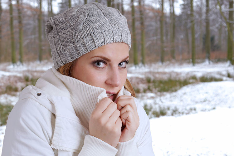 Close-Up Of Young Woman Wearing Warm Clothing