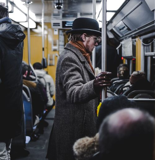 Man standing in train