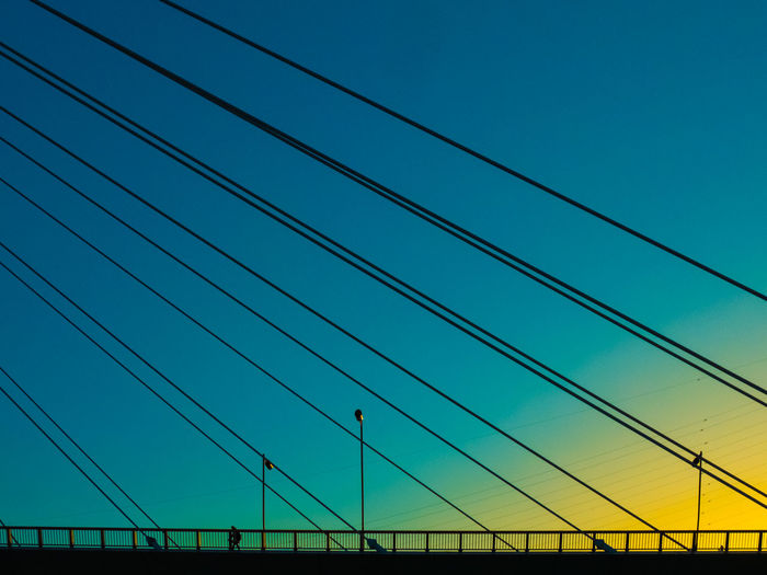 View Of Suspension Bridge Cables Against Sky At Sunset