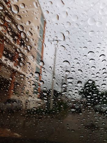After rain drops dew on the car glass Water Backgrounds Car Wash RainDrop Full Frame Drop Wet Window Weather Rain Car Interior Car Point Of View Rear-view Mirror Glass Rainy Season