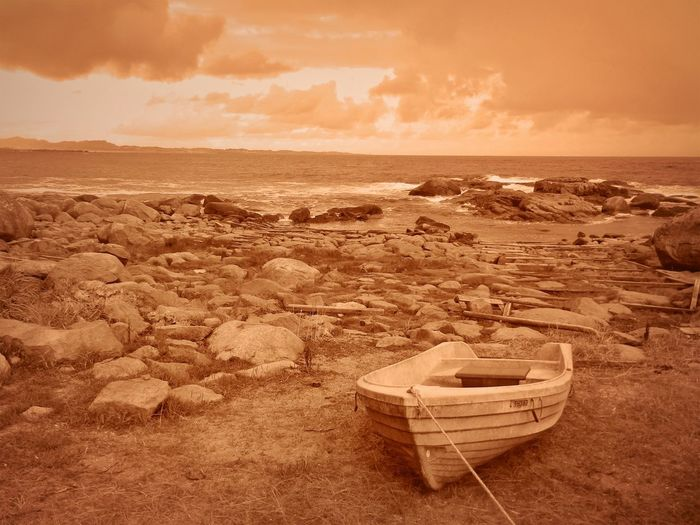 Norway Beach Beauty In Nature Cloud - Sky Horizon Horizon Over Water Land Mode Of Transportation Nature Nautical Vessel No People Rock Rowboat Scenics - Nature Sea Sepia Sky Sunset Tranquil Scene Tranquility Transportation Water