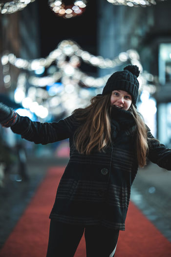 Young woman standing in city during winter