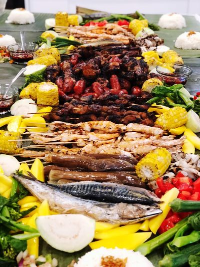 Boodle Fight also known by Filipinos as buffet food on banana leaves. EyeEmNewHere BoodleFight Filipino Food BBQ Chicken Shrimps Okra Mango Sisig Fish Corn On The Cob Longanisa